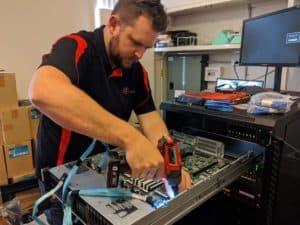 Lead Engineer Jason Replacing Motherboard